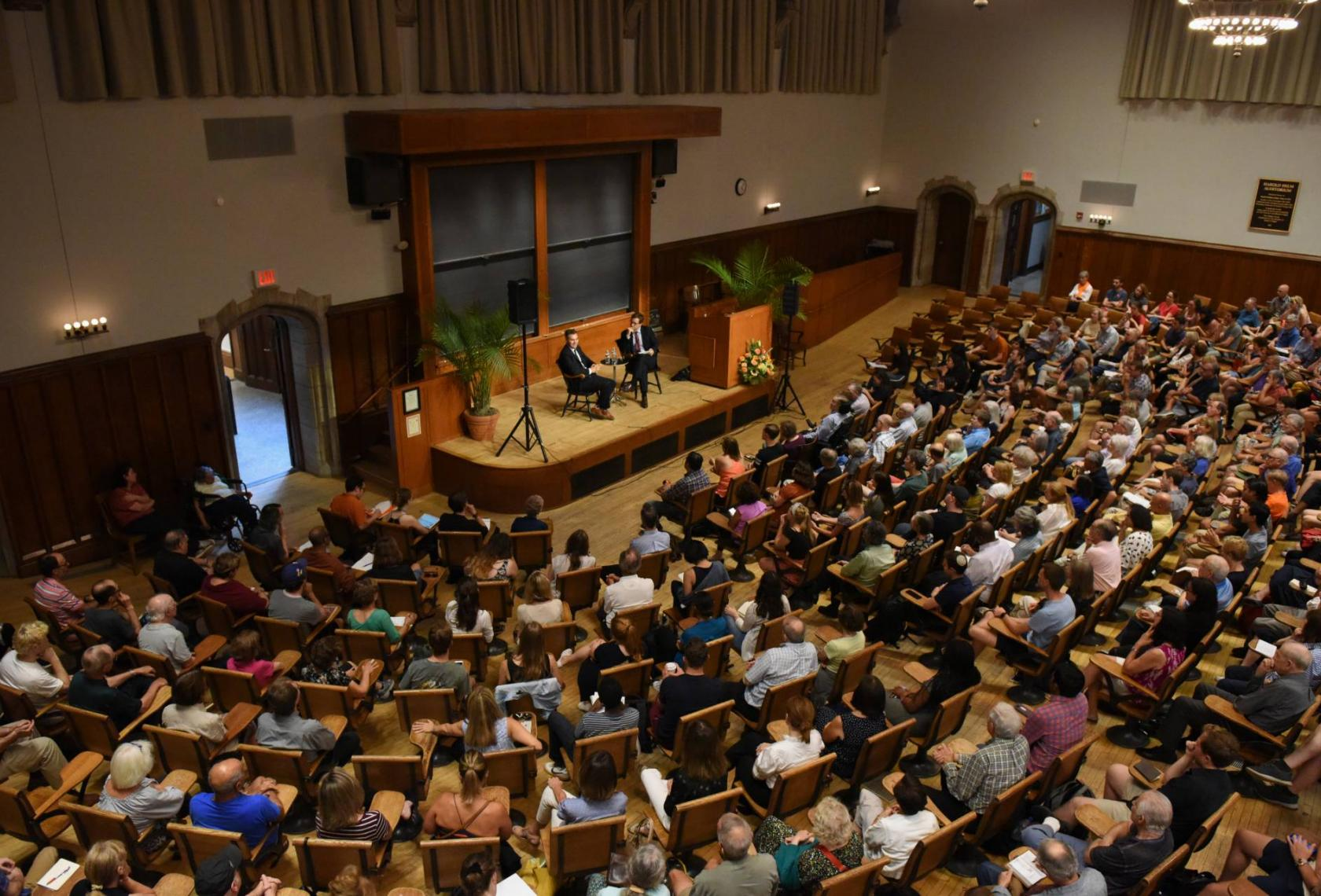 crowd of people attending an event in auditorium